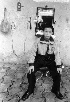 Tinh, barber Hanoi